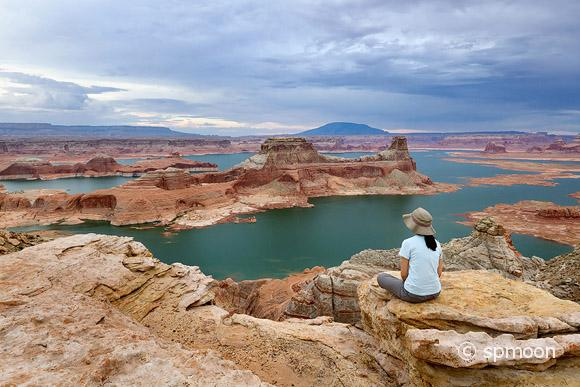 A woman enjoying the view from Alstrom Point, Lake Powell, Glen Canyon National Recreation Area.