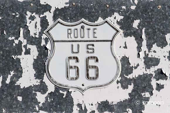 Old Route 66 Sign on peeling painted wall, CA