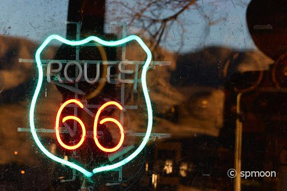 Route 66 neon sign on store window on historic route 66, AZ