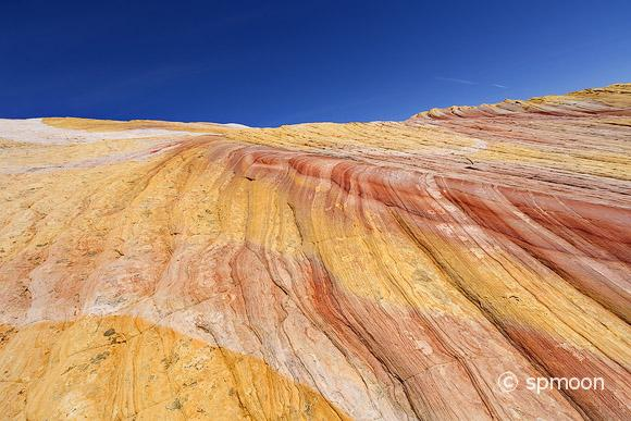 Multicolored sandstone rock on Cottonwood Canyon Road in Grand Staircase-Escalante National Monument, Utah