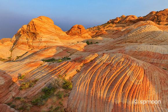 Yant Flat - red, orange, and white unsusal striped rock formation in Southern Utah - glowing in sunrise.