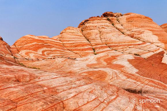 Yant Flat - red, orange, and white unusual striped rock formation in Southern Utah.