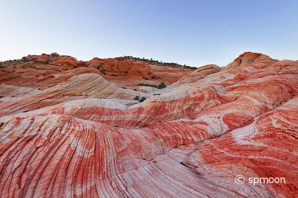 Yant Flat - red, orange, and white unsusal striped rock formation in Southern Utah - after sunset.