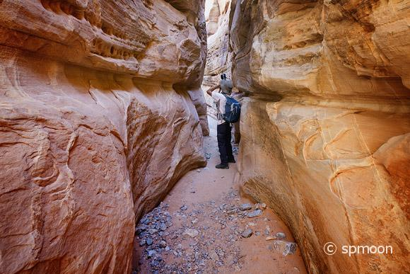 Photographer inside the slot canyon, Valley of Fire State Park, Nevada