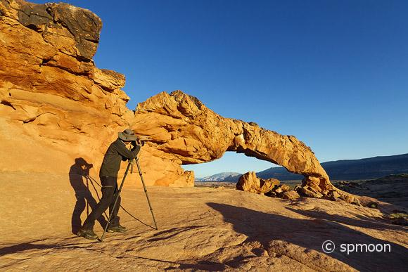 Photographer taking picture of Sunset Arch, Grand Staircase-Escalante National Monument, UT