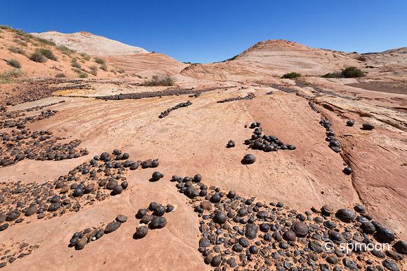 Moqui Marbles (Iron Oxide Concretions) from Navajo Sandstone, Grand Staircase-Escalante National Monument, UT.