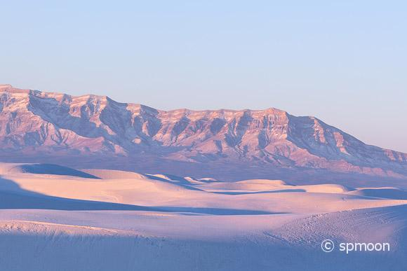 White sand dunes takes on pink color at sunrise, White Sands National Monument, New Mexico