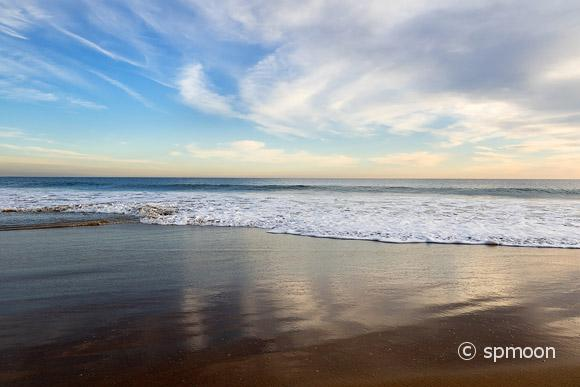 Sky reflecting on the beach at sunset, Orange County, California.