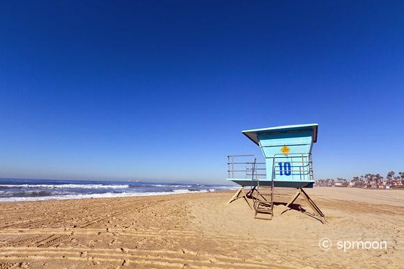 Lifeguard tower against blue sky in Huntington Beach, CA